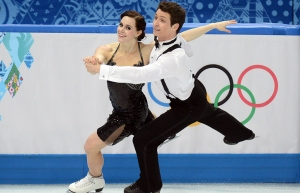 Canada's Scott Moir and Canada's Tessa Virtue perform in the Figure Skating Ice Dance Short Dance at the Iceberg Skating Palace during the Sochi Winter Olympics on February 16, 2014. AFP PHOTO / YURI KADOBNOVYURI KADOBNOV/AFP/Getty Images ORG XMIT: 461448105