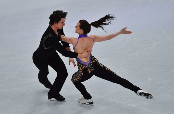 Canada's Tessa Virtue and Scott Moir compete in the ice dance/short dance event at the ISU World Figure Skating Championships in Helsinki, Finland on March 31, 2017. / AFP PHOTO / John MACDOUGALLJOHN MACDOUGALL/AFP/Getty Images