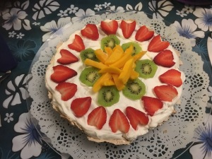 Fruit and cream with coconut/chocolate meringue crust.